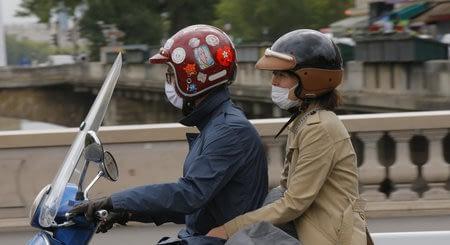 motards portant un masque